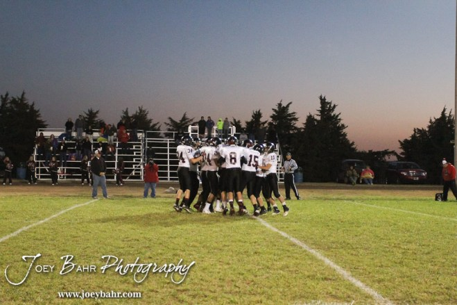 The Sylvan-Lucas Mustangs huddle up before the Sylvan-Lucas vs Otis-Bison High School football game with Otis-Bison winning 32 to 30 at Otis-Bison High School Field in Otis, Kansas on October 31, 2013. (Photo: Joey Bahr, www.joeybahr.com)