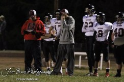 Sylvan-Lucas Mustang Head Coach Ben Labertew calls out to his players during the Sylvan-Lucas vs Otis-Bison High School football game with Otis-Bison winning 32 to 30 at Otis-Bison High School Field in Otis, Kansas on October 31, 2013. (Photo: Joey Bahr, www.joeybahr.com)