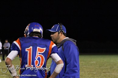 Otis-Bison Cougar Assistant Coach Curtis Little talks to Kade Urban (#15) during the Sylvan-Lucas vs Otis-Bison High School football game with Otis-Bison winning 32 to 30 at Otis-Bison High School Field in Otis, Kansas on October 31, 2013. (Photo: Joey Bahr, www.joeybahr.com)