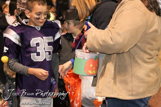 Kids line up to Trick or Treat at Halftime of the Sylvan-Lucas vs Otis-Bison High School football game with Otis-Bison winning 32 to 30 at Otis-Bison High School Field in Otis, Kansas on October 31, 2013. (Photo: Joey Bahr, www.joeybahr.com)