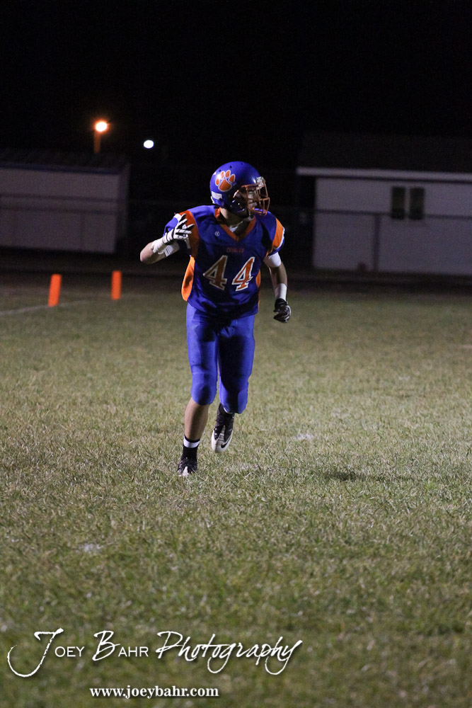Otis-Bison Cougar Hayden Maier (#44) runs a route during the Sylvan-Lucas vs Otis-Bison High School football game with Otis-Bison winning 32 to 30 at Otis-Bison High School Field in Otis, Kansas on October 31, 2013. (Photo: Joey Bahr, www.joeybahr.com)