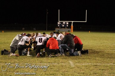 The Sylvan-Lucas Mustangs pray following the Sylvan-Lucas vs Otis-Bison High School football game with Otis-Bison winning 32 to 30 at Otis-Bison High School Field in Otis, Kansas on October 31, 2013. (Photo: Joey Bahr, www.joeybahr.com)