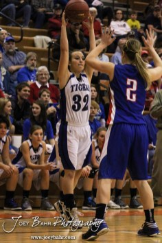St. John Lady Tiger Brandi Hanson (#32) passes the ball during the Opening Round of the Seventh Annual Keady Basketball Classic matchup between the Ellinwood Lady Eagles and the St. John Lady Tigers with Ellinwood winning 40 to 38 in overtime at Larned Middle School in Larned, Kansas on December 9, 2013. (Photo: Joey Bahr, www.joeybahr.com)
