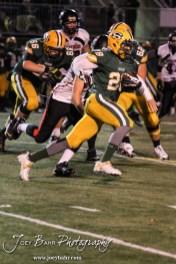 Salina South Cougar Mike Jones (#28) runs around the corner during the Great Bend versus Salina South High School football game with Salina South winning 56 to 13 at Salina Stadium in Salina, Kansas on November 1, 2013. (Photo: Joey Bahr, www.joeybahr.com)