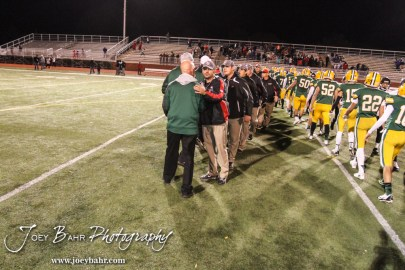 The coaches for both teams shake hands following the Great Bend versus Salina South High School football game with Salina South winning 56 to 13 at Salina Stadium in Salina, Kansas on November 1, 2013. (Photo: Joey Bahr, www.joeybahr.com)