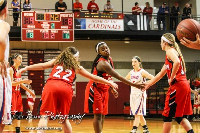 Hoisington Lady Cardinals Marisa Jonas (#22) and Jordin Greer (#10) encourage teammate Besa Bwalya (#15) after she missed a free throw during the 2014 Hoisington Cardinal Winter Jam Girls Third Place basketball game with the Hoisington Lady Cardinals versus the Russell Lady Broncos with Hoisington winning 39 to 27 at the Hoisington Activity Center in Hoisington, Kansas on January 25, 2014. (Photo: Joey Bahr, www.joeybahr.com)