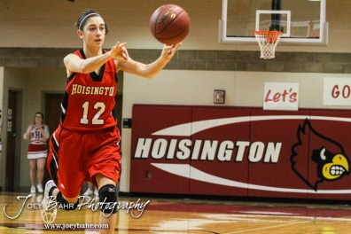 Hoisington Lady Cardinal Rylie Koester (#12) passes the ball to a teammate during the 2014 Hoisington Cardinal Winter Jam Girls Third Place basketball game with the Hoisington Lady Cardinals versus the Russell Lady Broncos with Hoisington winning 39 to 27 at the Hoisington Activity Center in Hoisington, Kansas on January 25, 2014. (Photo: Joey Bahr, www.joeybahr.com)