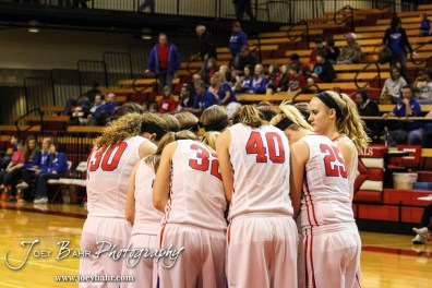The Russell Lady Broncos huddle for a prayer before the 2014 Hoisington Cardinal Winter Jam First Round basketball game with the Russell Lady Broncos versus the Ellsworth Lady Bearcats with Russell winning 54 to 52 in Hoisington Activity Center in Hoisington, Kansas on January 20, 2014. (Photo: Joey Bahr, www.joeybahr.com)