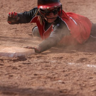 Great Bend Lady Panther Elizabeth Barber (#24) dives back for First Base during the Great Bend Lady Panthers versus Hays Lady Indians Softball game with Great Bend winning 14 to 3 at Veteran's Memorial Park West Field in Great Bend, Kansas on May 2, 2014. (Photo: Joey Bahr, www.joeybahr.com)