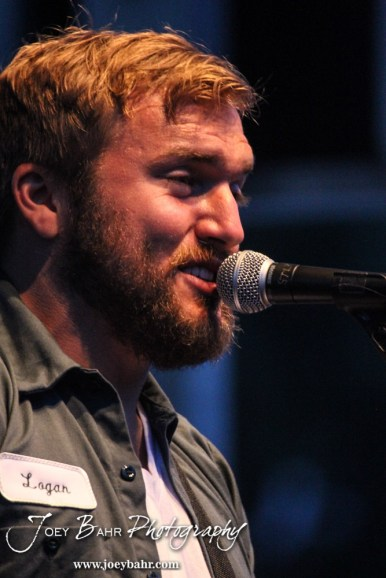 Logan Mize talks to the crowd durning the Ellinwood After Harvest Festival at City Park in Ellinwood, Kansas on July 17, 2014. (Photo: Joey Bahr, www.joeybahr.com)
