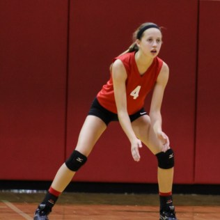 Kingman Lady Eagle Shyann Jackson (#4) prepares to return the ball during the Kingman Lady Eagles versus Larned Lady Indians volleyball match with Kingman winning 25-21, 24-26, 25-15 at Hoisington Activity Center in Hoisington, Kansas on September 9, 2014. (Photo: Joey Bahr, www.joeybahr.com)