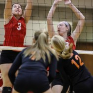 Kingman Lady Eagle Allison DeWeese (#3) goes to block a hit during the Kingman Lady Eagles versus Larned Lady Indians volleyball match with Kingman winning 25-21, 24-26, 25-15 at Hoisington Activity Center in Hoisington, Kansas on September 9, 2014. (Photo: Joey Bahr, www.joeybahr.com)