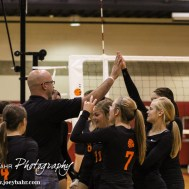 The Larned Lady Indians celebrate winning the second set during the Kingman Lady Eagles versus Larned Lady Indians volleyball match with Kingman winning 25-21, 24-26, 25-15 at Hoisington Activity Center in Hoisington, Kansas on September 9, 2014. (Photo: Joey Bahr, www.joeybahr.com)