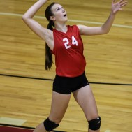 Kingman Lady Eagle Brianna Bradshaw (#24) serves the ball during the Kingman Lady Eagles versus Larned Lady Indians volleyball match with Kingman winning 25-21, 24-26, 25-15 at Hoisington Activity Center in Hoisington, Kansas on September 9, 2014. (Photo: Joey Bahr, www.joeybahr.com)