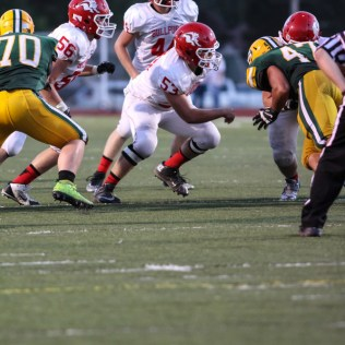 McPherson Bullpup Ross Regier (#53) moves to block a Salina South Cougar defender during the McPherson Bullpups versus Salina South Cougars High School Football gamme with Salina South winning 61 to 32 at Salina Stadium in Salina, Kansas on September 4, 2014. (Photo: Joey Bahr, www.joeybahr.com)