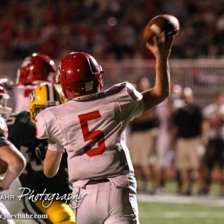 McPherson Bullpup Kyler Kinnamon (#5) throws a pass during the McPherson Bullpups versus Salina South Cougars High School Football gamme with Salina South winning 61 to 32 at Salina Stadium in Salina, Kansas on September 4, 2014. (Photo: Joey Bahr, www.joeybahr.com)