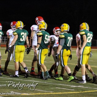 Members of the McPherson Bullpups and Salina South Cougars shake hands after the McPherson Bullpups versus Salina South Cougars High School Football gamme with Salina South winning 61 to 32 at Salina Stadium in Salina, Kansas on September 4, 2014. (Photo: Joey Bahr, www.joeybahr.com)