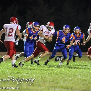 Kinsley Coyote Ross Frame (#5) rushes with the ball during the Otis-Bison versus Kinsley High School 8-Man Football Game with Otis-Bison winning 104 to 70 which set a new state record for combined points in a game at Cougar Field at Otis-Bison High School in Otis, Kansas on September 26, 2014. (Photo: Joey Bahr, www.joeybahr.com)