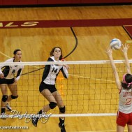 Central Plains Lady Oiler Taylor Rolfs (#14) goes for a kill as Macksville Lady Mustang Taylor Gillespie (#2) tries to block during the 2014 Central Prairie League Volleyball Tournament at Hoisington Activity Center in Hoisington, Kansas on October 18, 2014. (Photo: Joey Bahr, www.joeybahr.com)