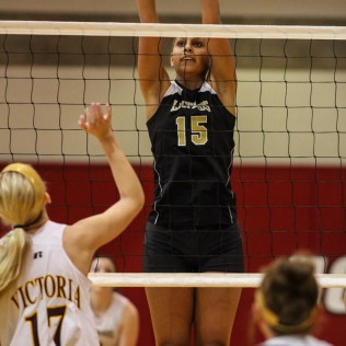 LaCrosse Lady Leopard Morgan West (#15) jumps to block a shot during the 2014 Central Prairie League Volleyball Tournament at Hoisington Activity Center in Hoisington, Kansas on October 18, 2014. (Photo: Joey Bahr, www.joeybahr.com)