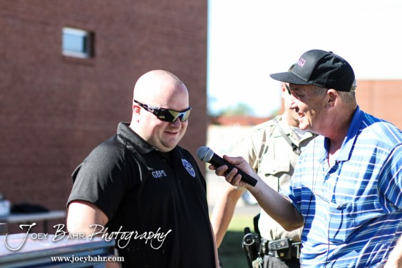 Steve Webster interviews Great Bend Police Department Officer Joel Hamlin during the KVGB AM 1590 City Edition Show with the Great Bend Police Department at Eagle Radio Broadcast Center in Great Bend, Kansas on October 15, 2014. (Photo: Joey Bahr, www.joeybahr.com)