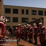 Hoisington Cardinal Brandon Ball (#9) is introduce before the Hoisington Cardinals versus Lyons Lions High School Football game with Hoisington winning 54 to 13 at Elton Brown Field at Hoisington High School in Hoisington, Kansas on October 30, 2014. (Photo: Joey Bahr, www.joeybahr.com)