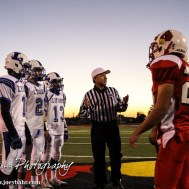 The Referee talks to the team captains before the Hoisington Cardinals versus Lyons Lions High School Football game with Hoisington winning 54 to 13 at Elton Brown Field at Hoisington High School in Hoisington, Kansas on October 30, 2014. (Photo: Joey Bahr, www.joeybahr.com)
