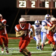 Hoisington Cardinal Hunter Hanzlick (#27) carries the football during the Hoisington Cardinals versus Lyons Lions High School Football game with Hoisington winning 54 to 13 at Elton Brown Field at Hoisington High School in Hoisington, Kansas on October 30, 2014. (Photo: Joey Bahr, www.joeybahr.com)