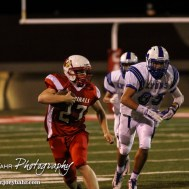 Hoisington Cardinal Hunter Hanzlick (#27) carries the ball during the Hoisington Cardinals versus Lyons Lions High School Football game with Hoisington winning 54 to 13 at Elton Brown Field at Hoisington High School in Hoisington, Kansas on October 30, 2014. (Photo: Joey Bahr, www.joeybahr.com)