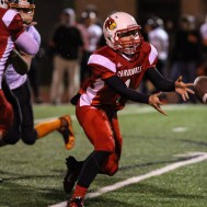 Hoisington Cardinal Tyler Specht (#1) tosses the ball during the Hoisington High School versus Smoky Valley football game with Hoisington winning 33 to 12 at Eldon Brown Field in Hoisington, Kansas on October 10, 2014. (Photo: Joey Bahr, www.joeybahr.com)