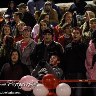 A Hoisington Cardinal fan cheers on the team during the Hoisington High School versus Smoky Valley football game with Hoisington winning 33 to 12 at Eldon Brown Field in Hoisington, Kansas on October 10, 2014. (Photo: Joey Bahr, www.joeybahr.com)
