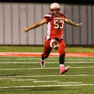 Hoisington Cardinal Chris Wright (#53) punts the ball during the Hoisington High School versus Smoky Valley football game with Hoisington winning 33 to 12 at Eldon Brown Field in Hoisington, Kansas on October 10, 2014. (Photo: Joey Bahr, www.joeybahr.com)
