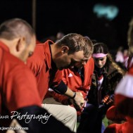 Hoisington Cardinal Head Coach Zach Baird leads his team in prayer follwoing the Hoisington High School versus Smoky Valley football game with Hoisington winning 33 to 12 at Eldon Brown Field in Hoisington, Kansas on October 10, 2014. (Photo: Joey Bahr, www.joeybahr.com)
