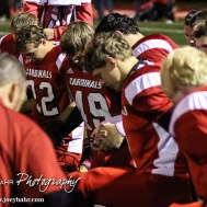 Members of the Hoisington Cardinals pray after the Hoisington High School versus Smoky Valley football game with Hoisington winning 33 to 12 at Eldon Brown Field in Hoisington, Kansas on October 10, 2014. (Photo: Joey Bahr, www.joeybahr.com)