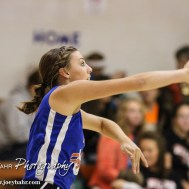 Otis-Bison Lady Cougar Taylor Regan (#10) serves the ball during the Otis-Bison/LaCrosse Volleyball Tournament Pool Play at Otis-Bison High School in Otis, Kansas on September 13, 2014. (Photo: Joey Bahr, www.joeybahr.com)
