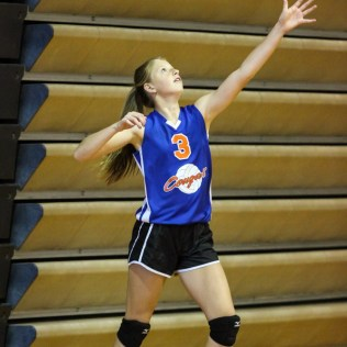 Otis-Bison Lady Cougar Molly Schneider (#3) serves the ball during the Otis-Bison Lady Cougar Junior Varsity Volleyball Game with the Ellinwood Lady Eagles at Ellinwood High School in Ellinwood, Kansas on October 14, 2014. (Photo: Joey Bahr, www.joeybahr.com)