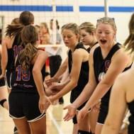 The Otis-Bison Lady Cougars greet their teammates prior to the Otis-Bison High School versus Macksville volleyball game at Otis-Bison High School in Otis, Kansas on October 7, 2014. (Photo: Joey Bahr, www.joeybahr.com)