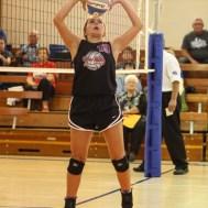Otis-Bison Lady Cougar Demi Bartonek (#19) sets the ball during the Otis-Bison High School versus Macksville volleyball game at Otis-Bison High School in Otis, Kansas on October 7, 2014. (Photo: Joey Bahr, www.joeybahr.com)