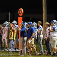 Spearville Lancer Assistant Coach Chris Sohm and Head Coach Matt Fowler call in the defensive formation during the Spearville at Hodgeman County High School Football Game with Spearville winning 50 to 28 at Sayler Field in Jetmore, Kansas on October 24, 2014. (Photo: Joey Bahr, www.joeybahr.com)