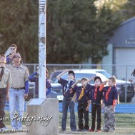 Cub and Boy Scouts salute the flag during the National Anthem before the Spearville versus Ness City High School 8-Man Football Game with Spearville winning 50 to 38 at Ness City High School in Ness City, Kansas on October 3, 2014. (Photo: Joey Bahr, www.joeybahr.com)