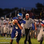 Ness City Eagle Tanner Mcmillen (#5) scrambles with the ball during the Spearville versus Ness City High School 8-Man Football Game with Spearville winning 50 to 38 at Ness City High School in Ness City, Kansas on October 3, 2014. (Photo: Joey Bahr, www.joeybahr.com)