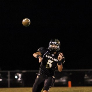 LaCrosse Leopard Jack Garcia (#5) throws a pass during the KSHSAA Class 2-1A Regional Football game with Meade at LaCrosse with LaCrosse winning 34 to 0 at Bill Schoendaller Athletic Field in LaCrosse, Kansas on November 7, 2014. (Photo: Joey Bahr, www.joeybahr.com)