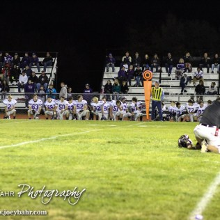 The Meade Buffaloes take a knee as trainers look after a LaCrosse Leopard during the KSHSAA Class 2-1A Regional Football game with Meade at LaCrosse with LaCrosse winning 34 to 0 at Bill Schoendaller Athletic Field in LaCrosse, Kansas on November 7, 2014. (Photo: Joey Bahr, www.joeybahr.com)