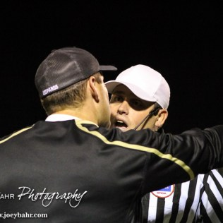 LaCrosse Leopard Head Coach Jon Webster discusses a call with the Head Referee during the KSHSAA Class 2-1A Regional Football game with Meade at LaCrosse with LaCrosse winning 34 to 0 at Bill Schoendaller Athletic Field in LaCrosse, Kansas on November 7, 2014. (Photo: Joey Bahr, www.joeybahr.com)