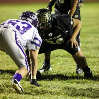 LaCrosse Leopard Tyler Davis (#66) prepares to hike the ball during the KSHSAA Class 2-1A Regional Football game with Meade at LaCrosse with LaCrosse winning 34 to 0 at Bill Schoendaller Athletic Field in LaCrosse, Kansas on November 7, 2014. (Photo: Joey Bahr, www.joeybahr.com)