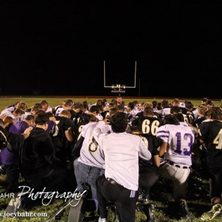 Members of the Meade Buffaloes and LaCrosse Leopards meet and pray following the KSHSAA Class 2-1A Regional Football game with Meade at LaCrosse with LaCrosse winning 34 to 0 at Bill Schoendaller Athletic Field in LaCrosse, Kansas on November 7, 2014. (Photo: Joey Bahr, www.joeybahr.com)