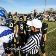 The Referee tosses the coin before the KSHSAA Eight Man Division I Regional Football game between Spearville and Central Plains with Central Plains winning 42 to 40 at Central Plains High School in Claflin, Kansas on November 8, 2014. (Photo: Joey Bahr, www.joeybahr.com)