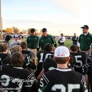 Central Plains Oiler Head Coach Chris Steiner addresses his players following the KSHSAA Eight Man Division I Regional Football game between Spearville and Central Plains with Central Plains winning 42 to 40 at Central Plains High School in Claflin, Kansas on November 8, 2014. (Photo: Joey Bahr, www.joeybahr.com)