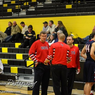 Olathe North Eagle Head Coach Jeff Walton confers with his assistants during the First Round of the Gerald Mitchell Hays City Shoot-Out basketball game between the Olathe North Eagles and the Newton Railers with Olathe North winning 46 to 34 at Hays Felton Middle School in Hays, Kansas on December 4, 2014. (Photo: Joey Bahr, www.joeybahr.com)