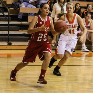Kinsley Lady Coyote Kate Gleason (#25) drives to the basket during Seventh Annual Keady Basketball Classic First Round game between the Kinsley Lady Coyotes and the Larned Lady Indians with Kinsley winning 47 to 31 at Larned Middle School in Larned, Kansas on December 8, 2014. (Photo: Joey Bahr, www.joeybahr.com)